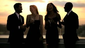 stock-footage-multi-ethnic-attractive-male-and-female-friends-drinking-toasting-at-luxury-outdoor-cocktail-hour