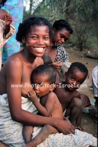 Africa, Madagascar, Smiling mother breast feeds her baby