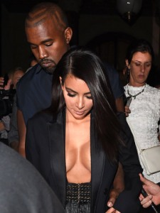 000029792-Kim_Kardashian_and_Kanye_West_Paris_Fashion_Week