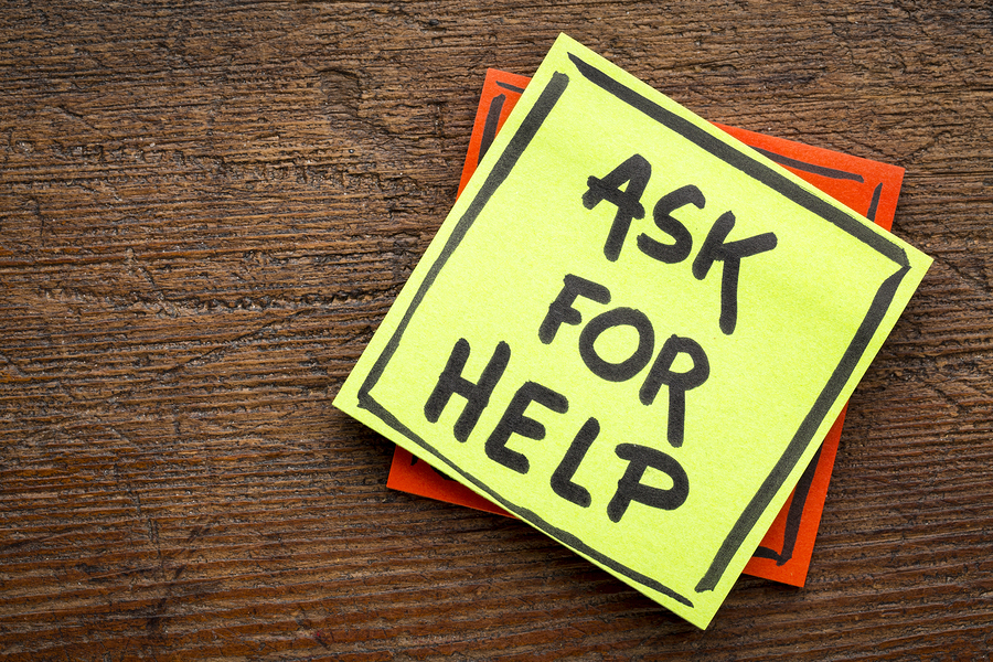 Ask for help advice or reminder - handwriting on a sticky note a